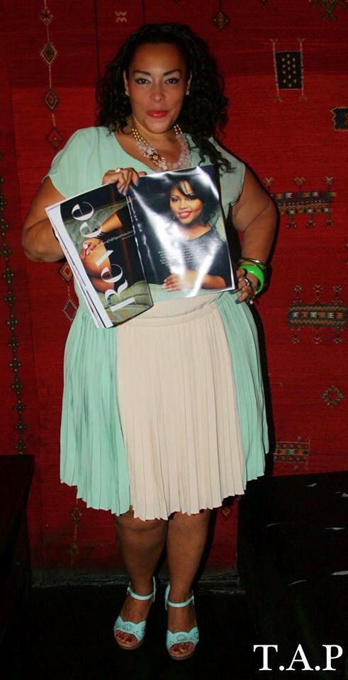 Me holding the copy of DeVoe Magazine at launch party